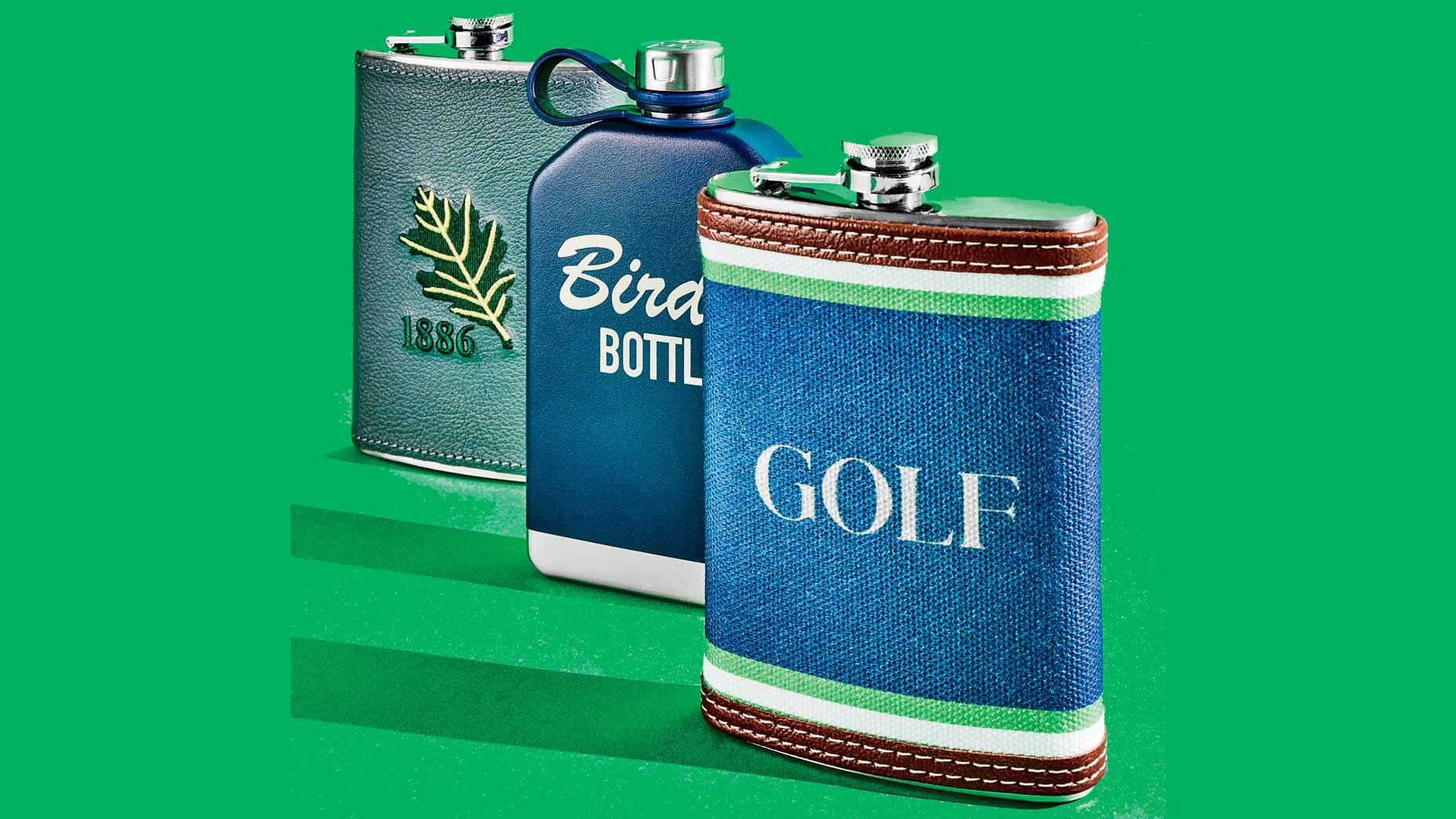 three flasks on green background