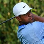 Golfer Tony Finau watches drive