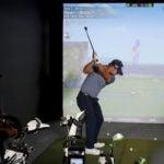 golfer hits on a simulator