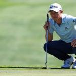 Pro golfer Collin Morikawa reads putt