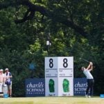 Scottie Scheffler hits his tee shot on the 8th hole at Colonial Country Club.