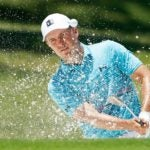 Jordan Spieth hits from a bunker on the first hole at Colonial Country Club.