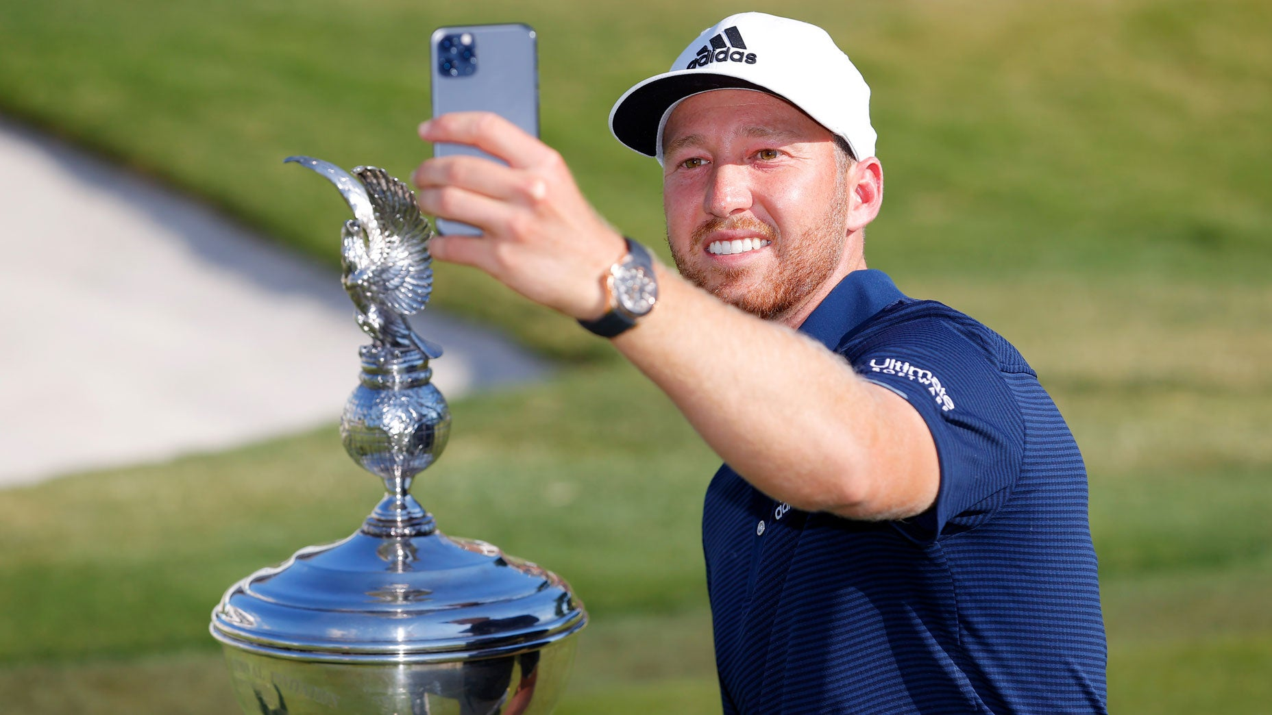 Daniel Berger takes a selfie of himself with the Schwab Challenge trophy