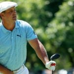 Bryson DeChambeau watches a drive on Sunday at Colonial.
