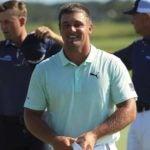 Pro golfer Bryson DeChambeau smiles on golf course