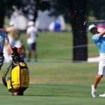caddie and player socially distance