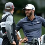 dustin johnson talks to caddie
