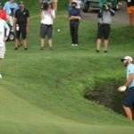 Dustin Johnson hits from the water.