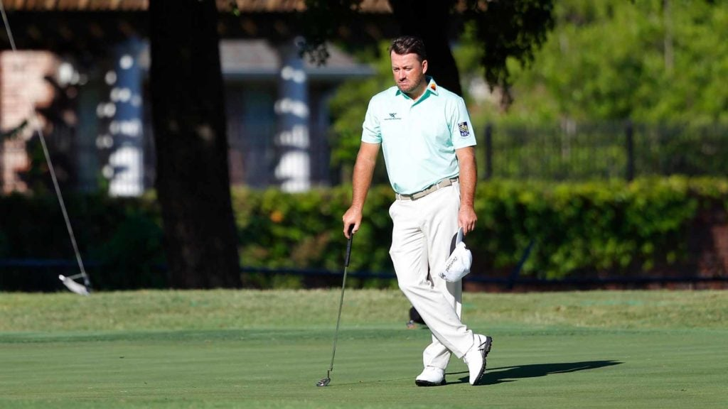 Pro golfer Graeme McDowell stand on golf course