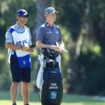 webb simpson stands next to caddie heritage