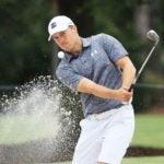 Pro golfer Jordan Spieth hits sand shot