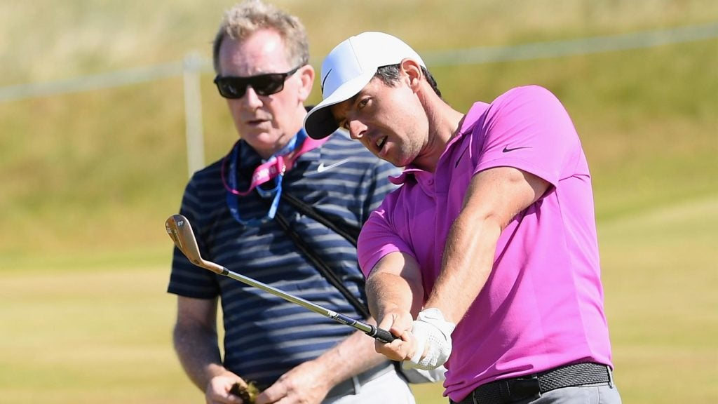 Michael Bannon works with Rory McIlroy before a round.