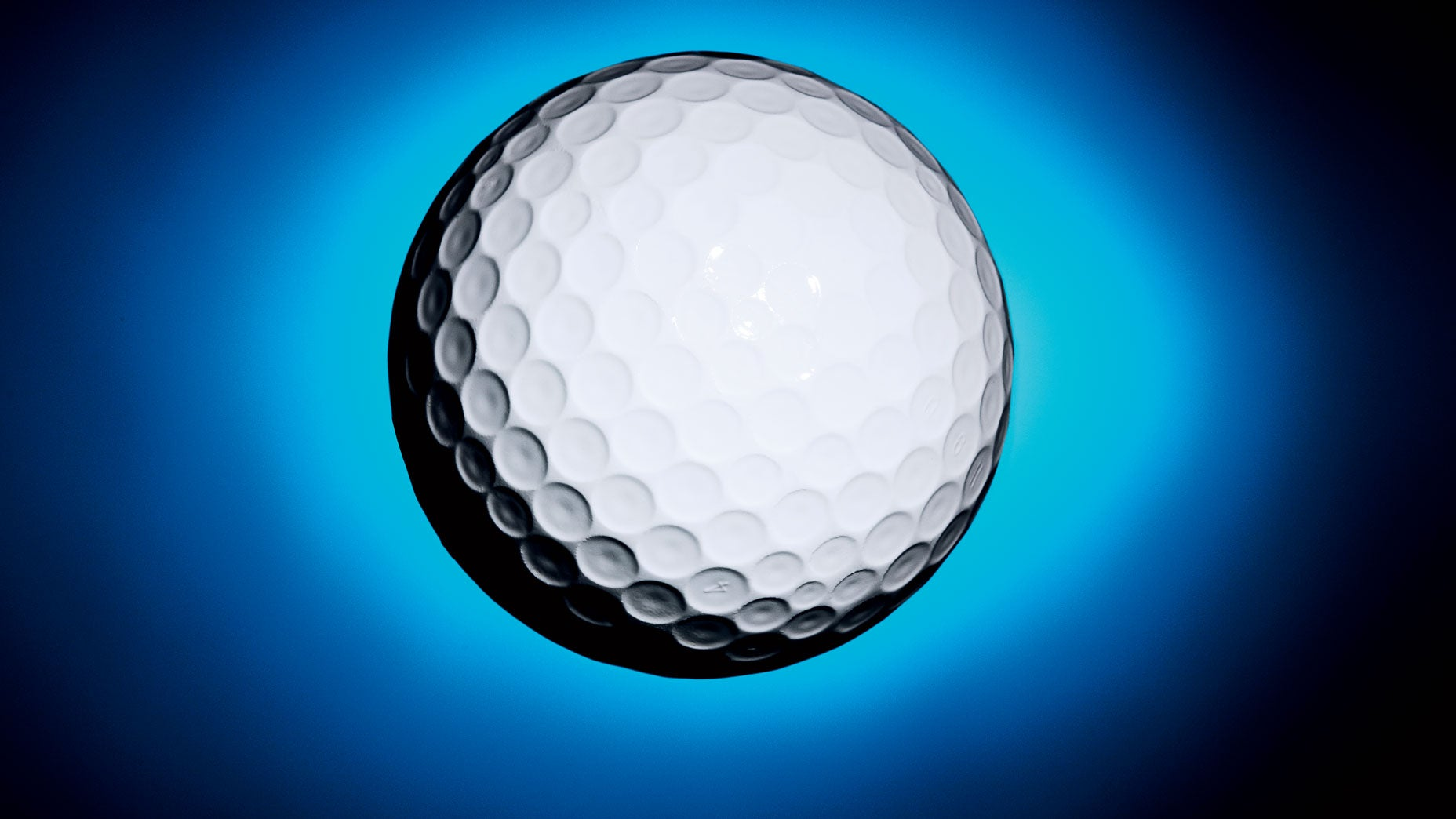 Golf ball on blue background