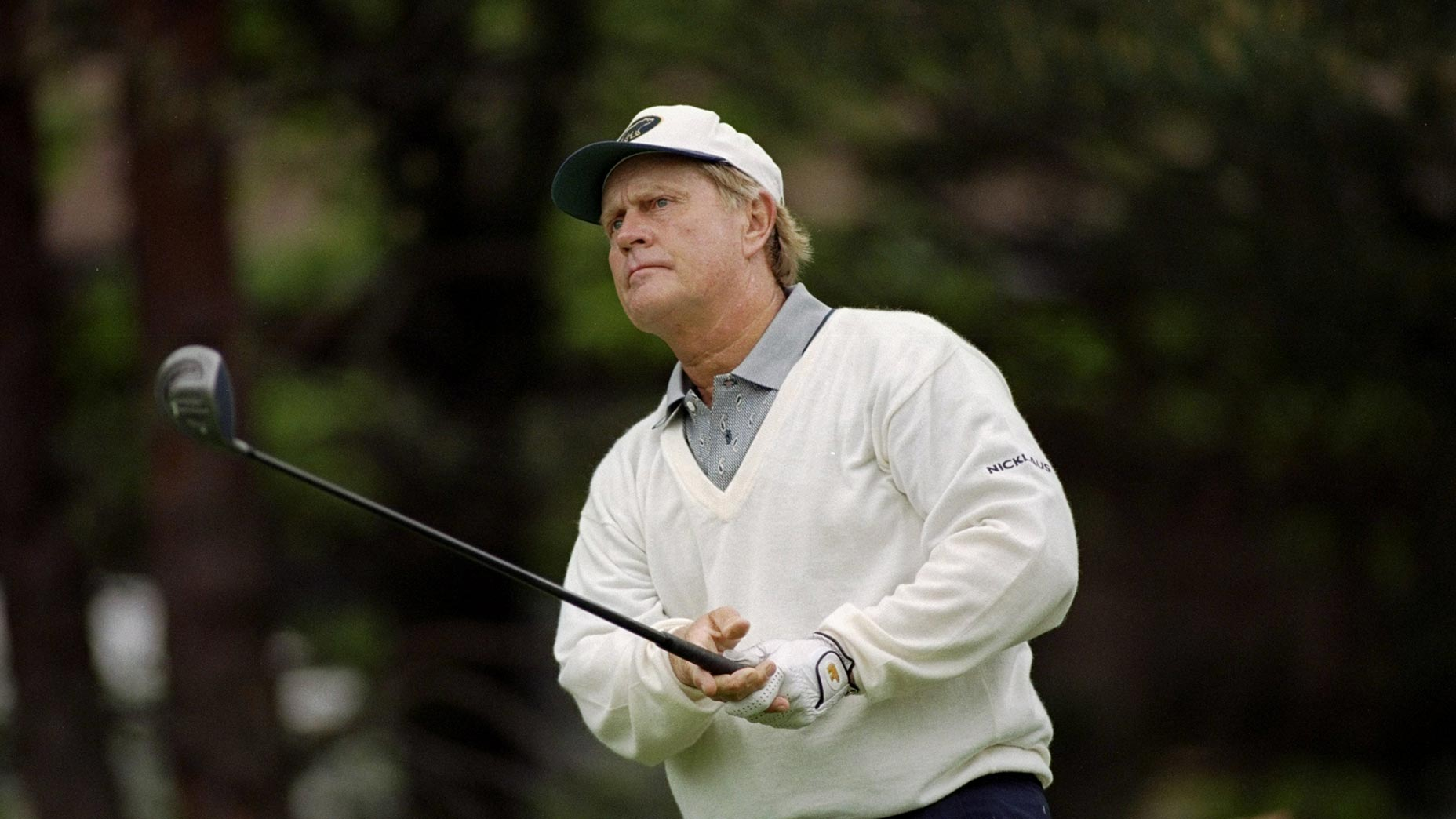 jack nicklaus holds driver after swing