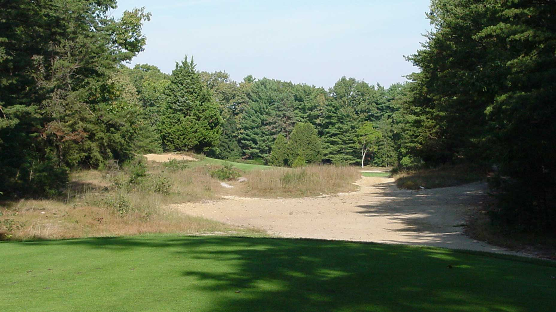 The tee shot on the par-4 11th at Pine Valley.