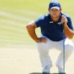 Patrick Reed reads a putt.