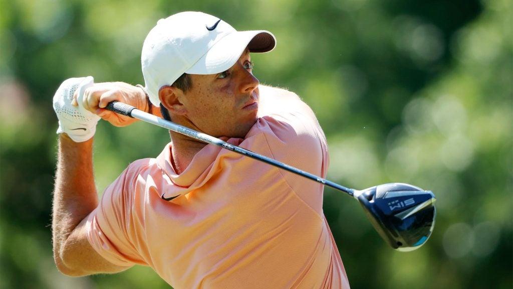 Rory McIlroy swings a golf club.