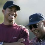 Tiger and Earl Woods smile