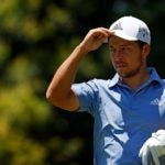 xander schauffele touches cap at colonial