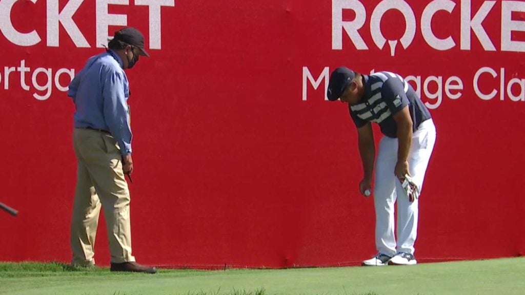Bryson DeChambeau takes a drop at the Rocket Mortgage Classic.
