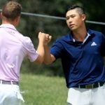 collin morikawa fist bumps justin thomas