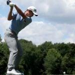 Collin Morikawa swings.