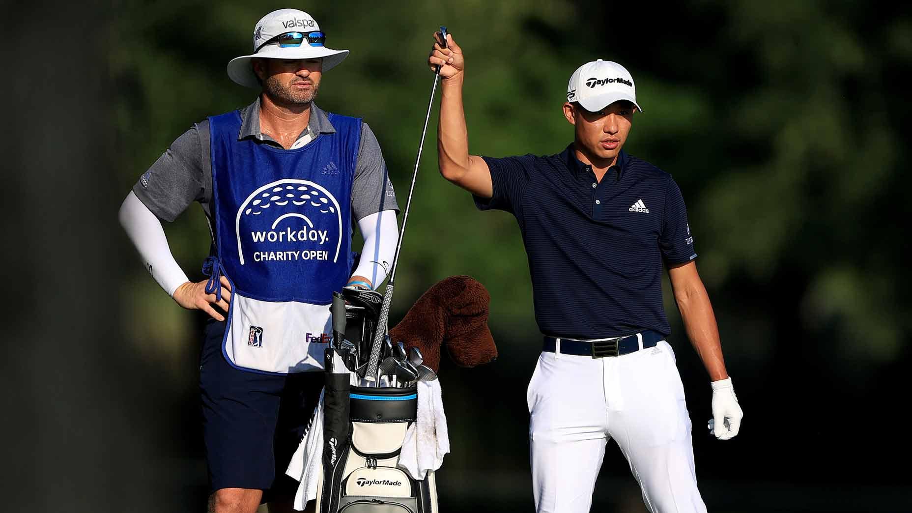 Pro golfer Collin Morikawa with caddie