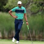 tony finau holds putter