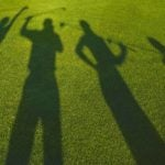 Shadow of golfers