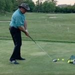 Golf instructor demonstrates drill