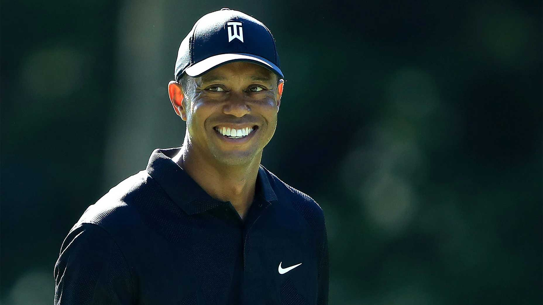 Tiger Woods smiles at the Memorial.