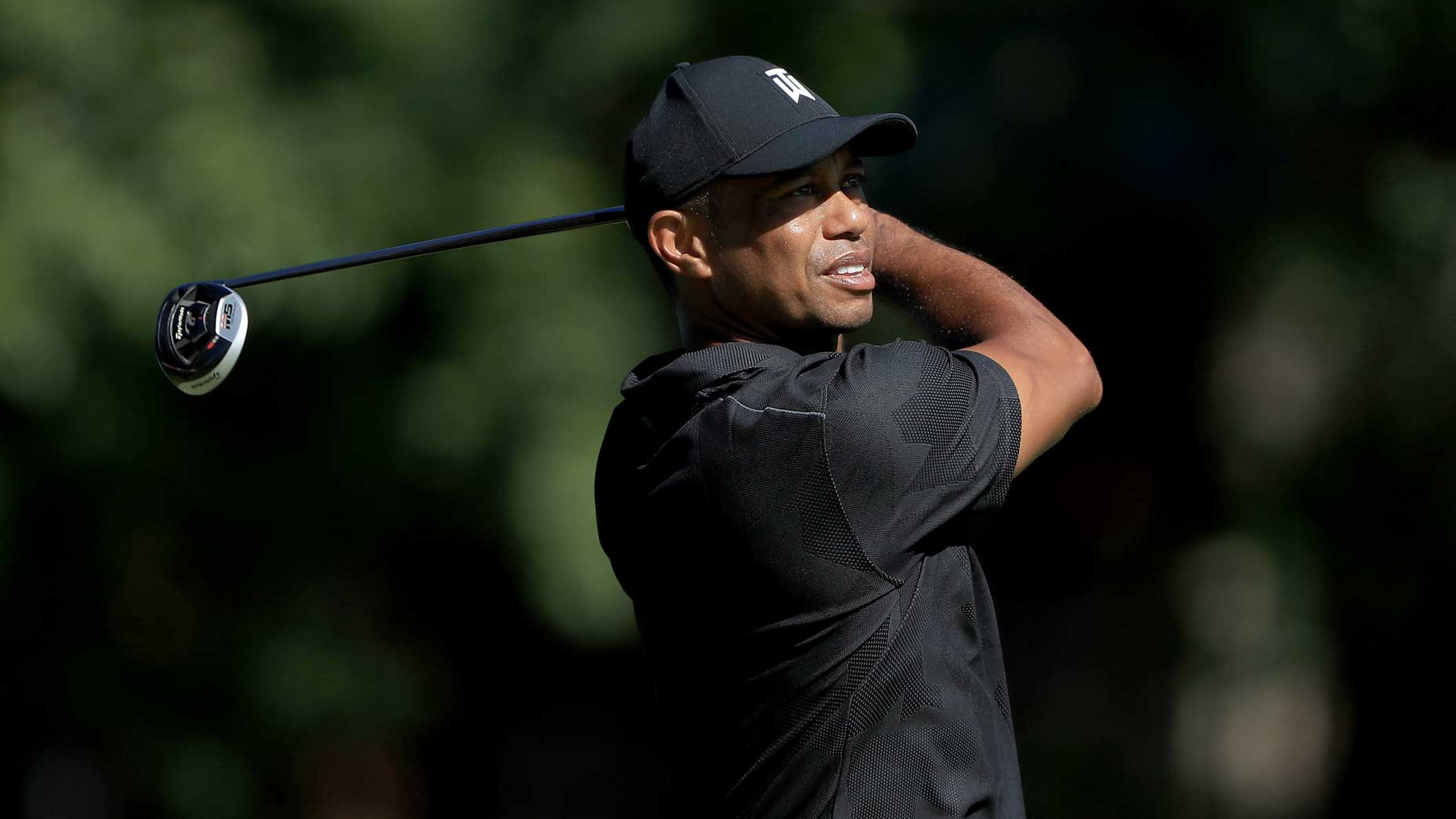 Tiger Woods hits driver