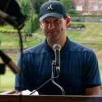 tony romo speaks at the podium