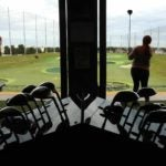 golfers play topgolf