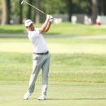 webb simpson hits a shot