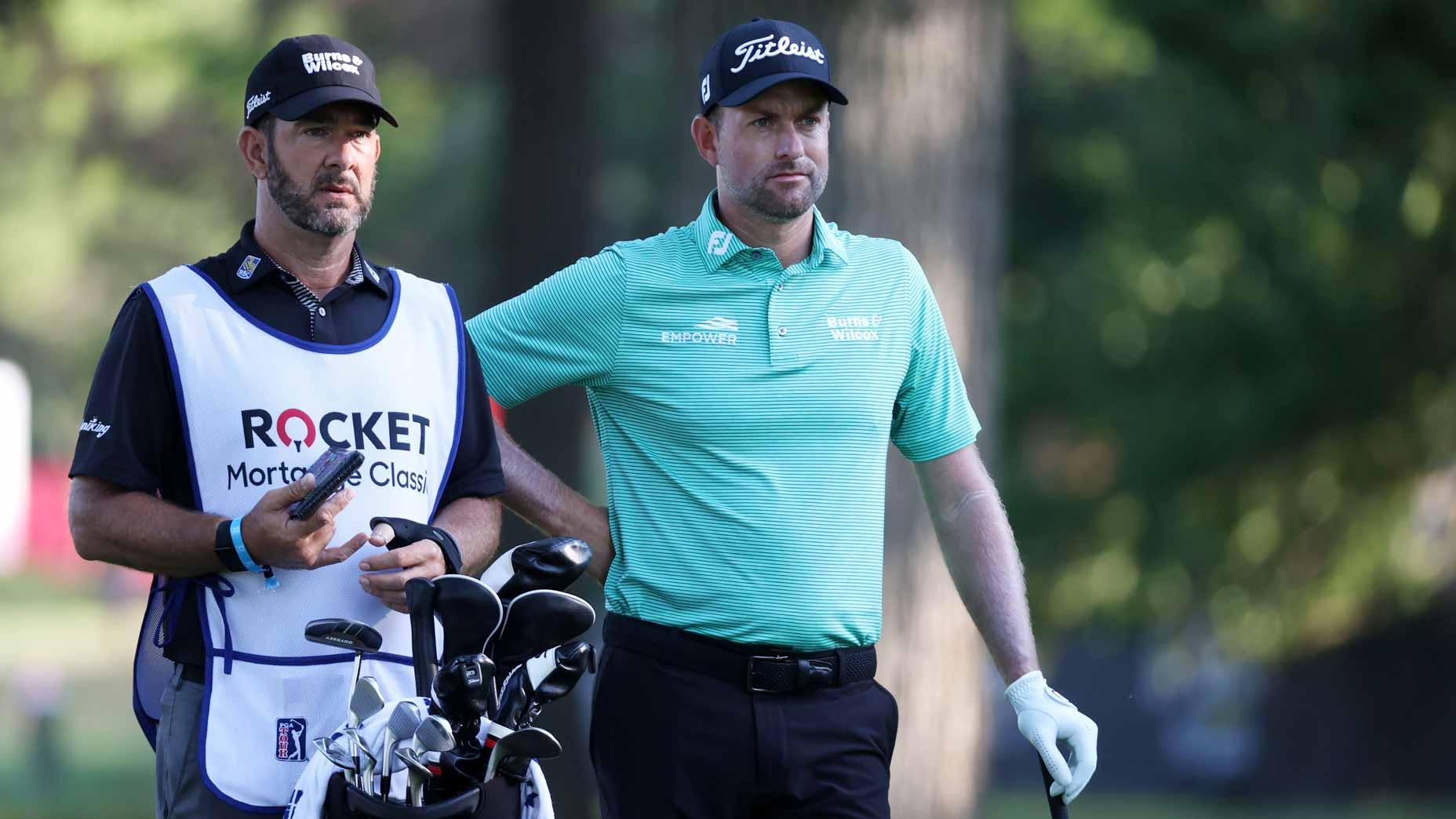 Pro golfer Webb Simpson with caddie