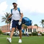Dustin Johnson using a TaylorMade carry golf bag.
