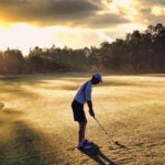playing golf alone
