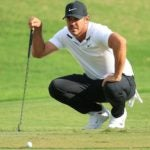 Brooks Koepka reads putt