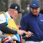 bryson dechambeau smiles after breaking driver