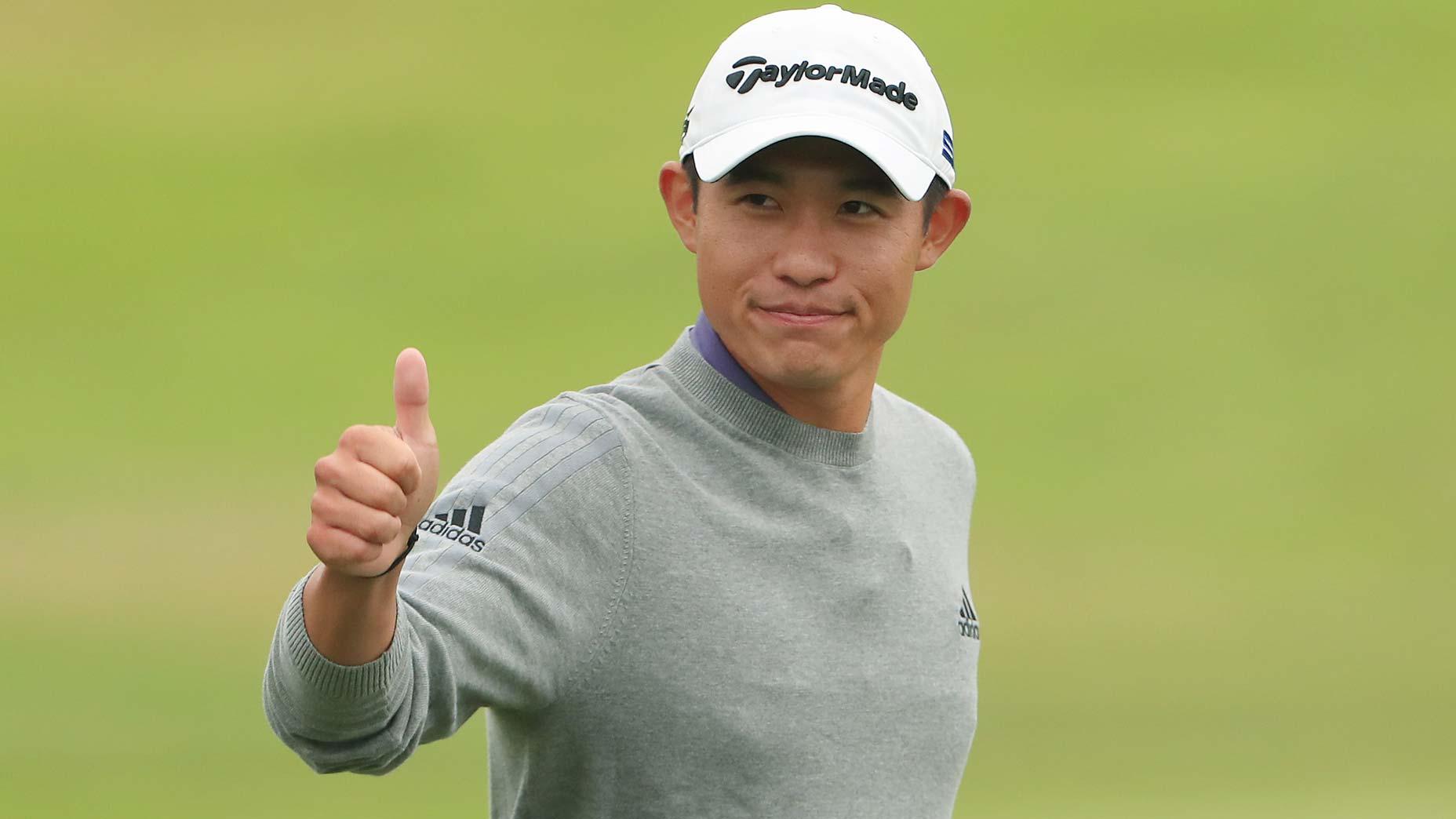 collin morikawa gives a thumbs up
