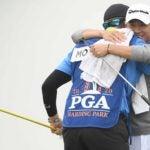 collin morikawa hugs his caddie at pga championship