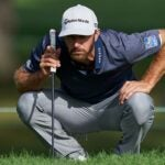 dustin johnson crouches over putt