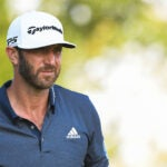 dustin johnson looks on at northern trust