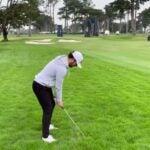 golfer swings harding park rough