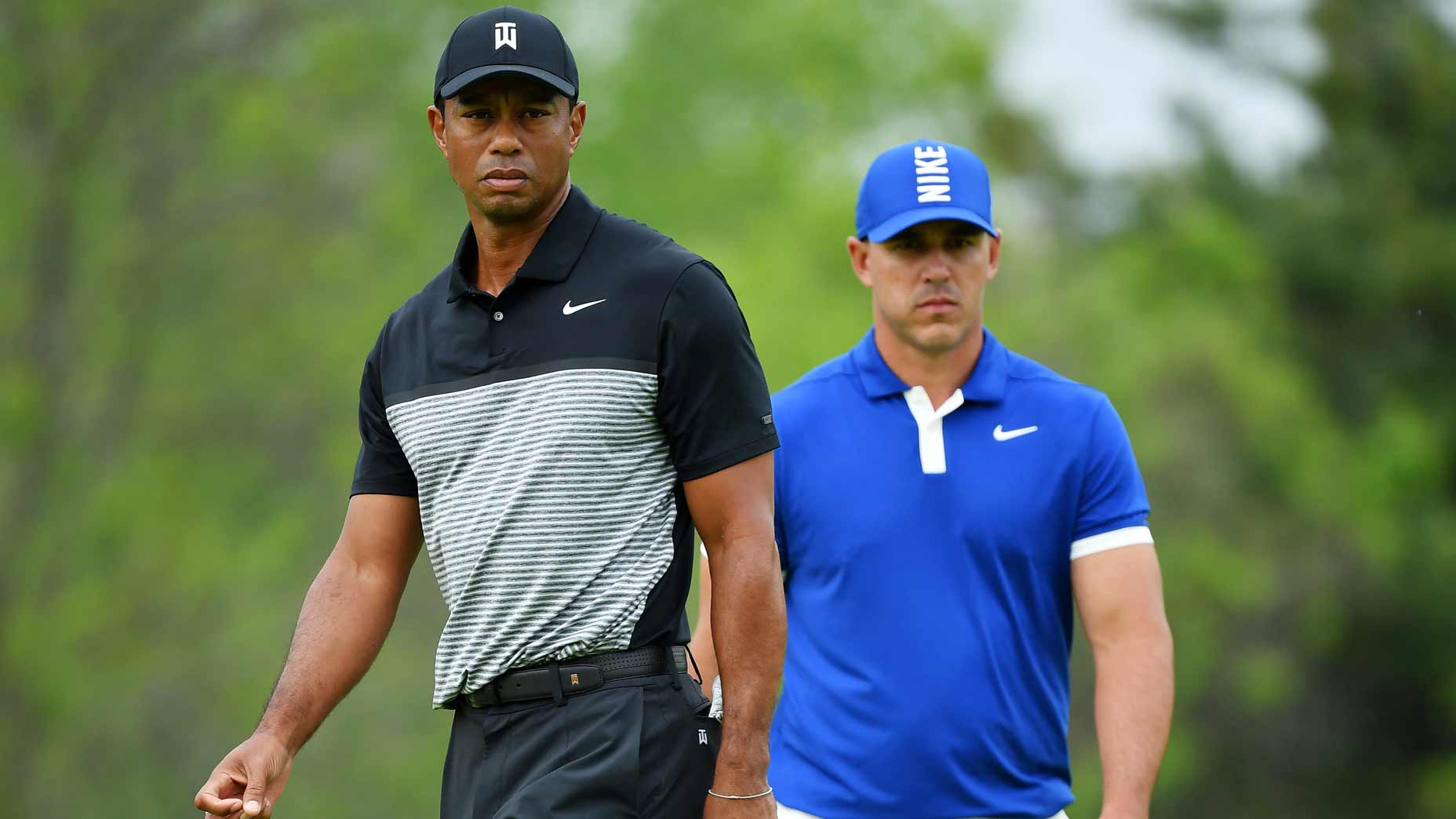 Golfers Tiger Woods and Brooks Koepka