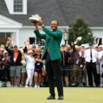 Tiger Woods holds up Masters trophy.