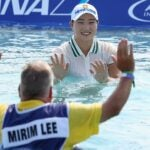 Mirim Lee and caddie