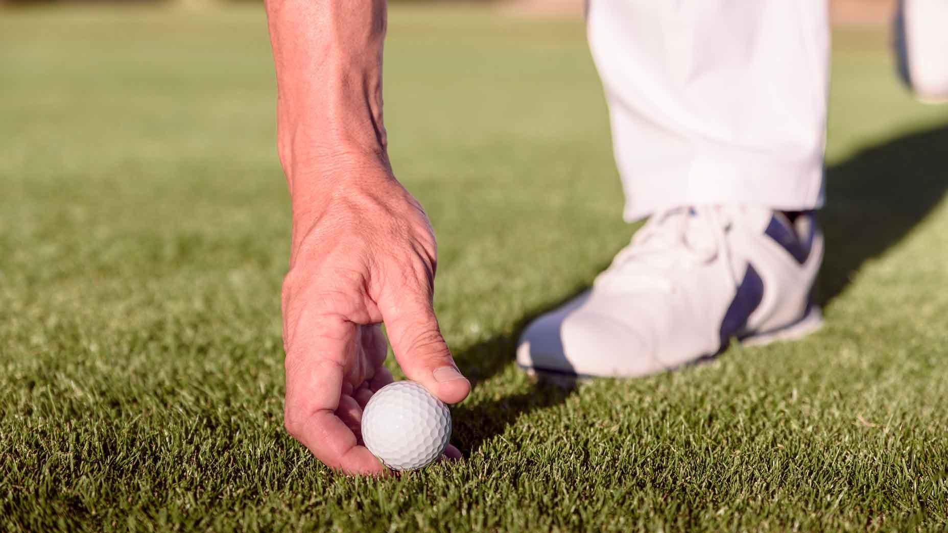 Golfer placing ball