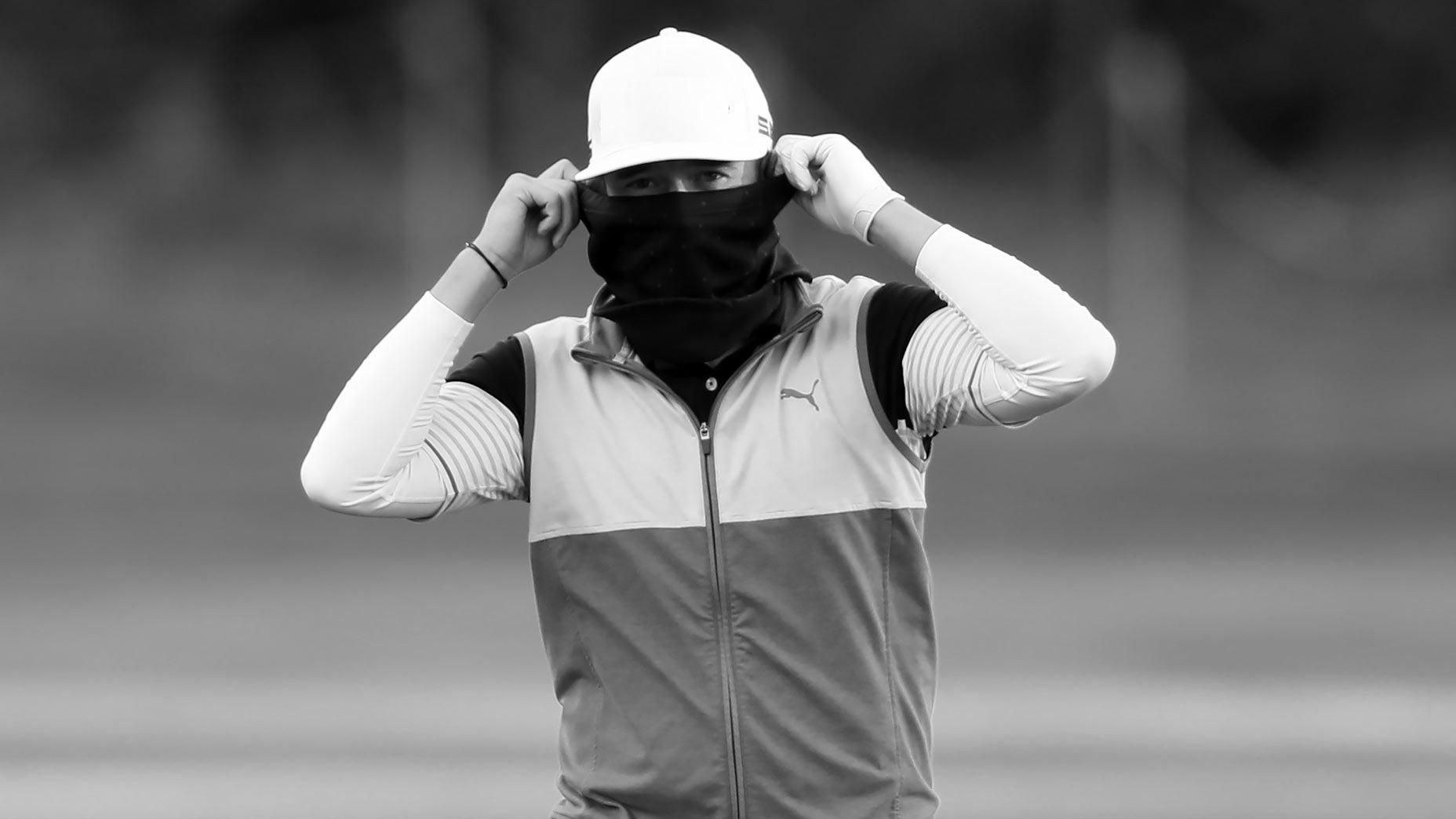 masked golfer